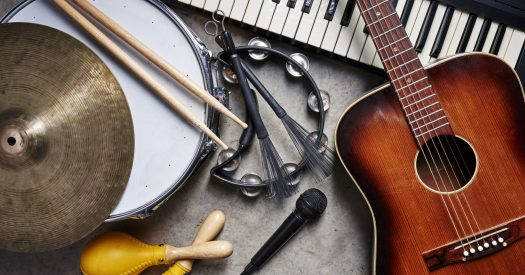 Guitar, drums, keyboard, and other instruments together.