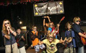 Children on instruments in the DeAngelis Rock School.