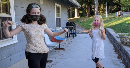 DeAngelis Students playing outside in masks.